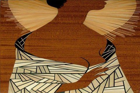 Oeuvre de Marqueterie représentant une femme auréolée
